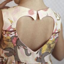 heart cutout on back of girls' dress