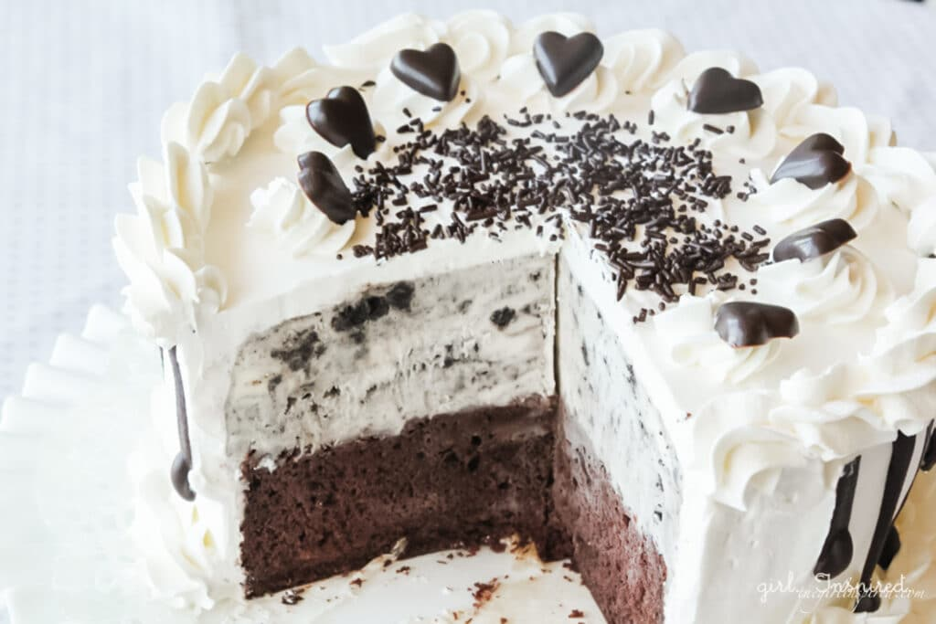 oreo ice cream cake with slice removed on white plate