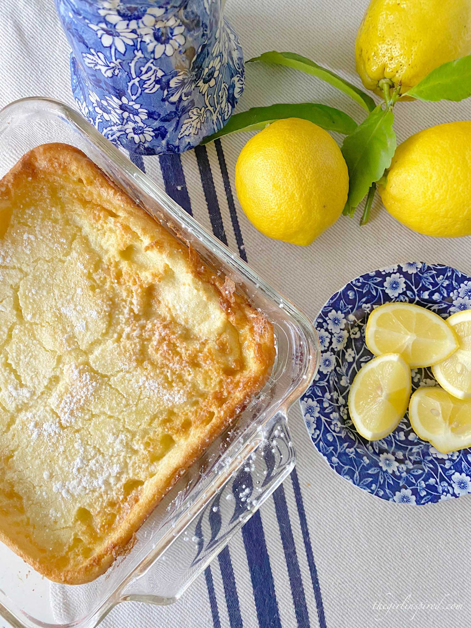 German pancake, lemons, lemon slices and blue plate