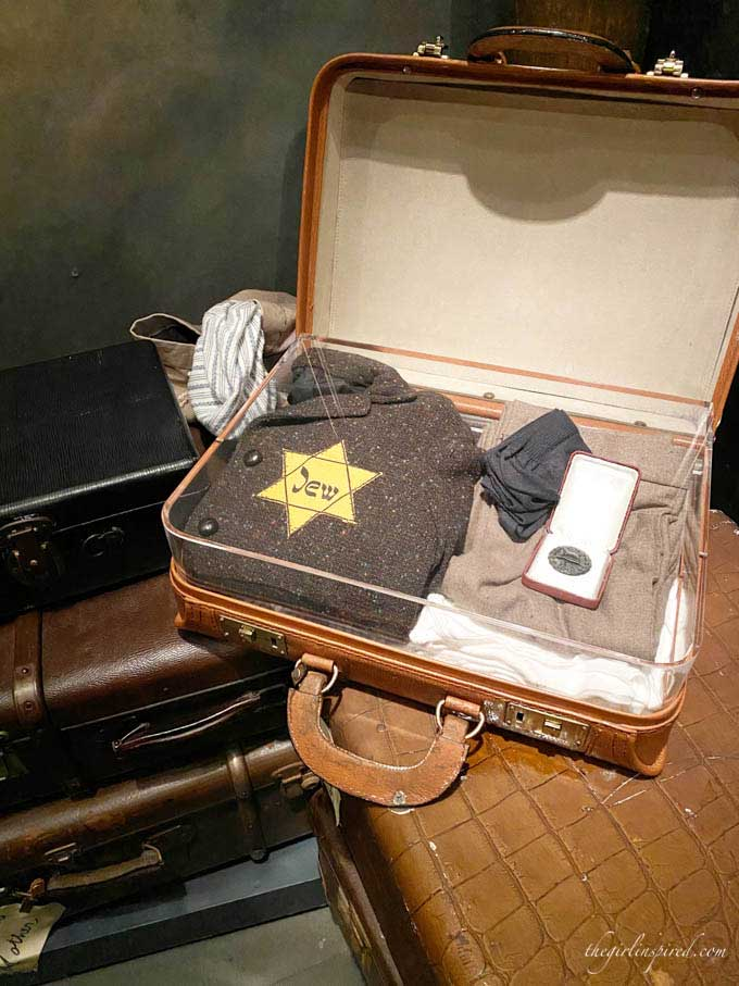 small suitcase with clothing and yellow star, sitting on table