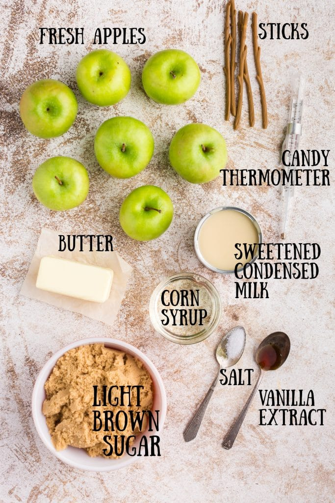 ingredients for caramel apples with text overlay: green apples, butter, brown sugar, vanilla, salt, sweetened condensed milk, sticks and candy thermometer