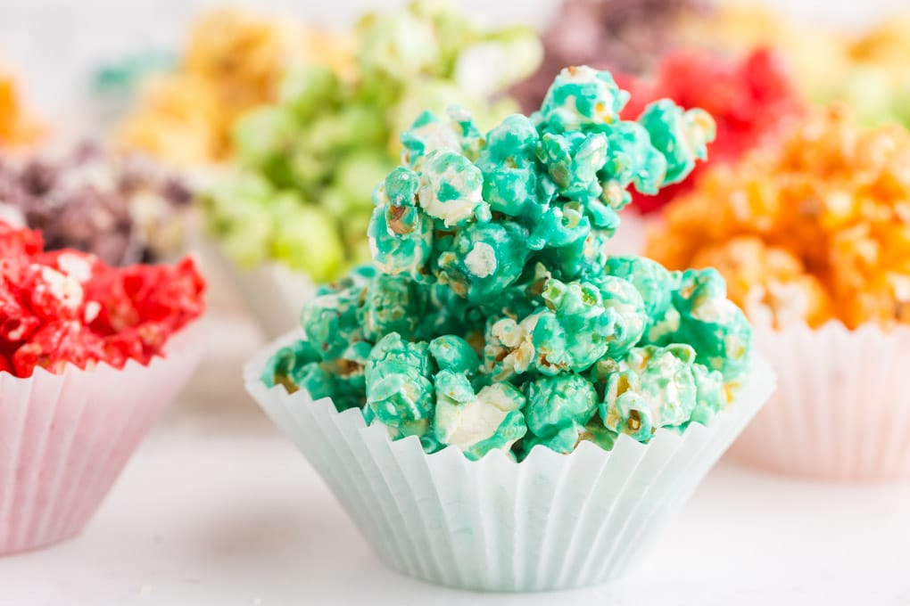 blue popcorn in cupcake liner with other colors behind