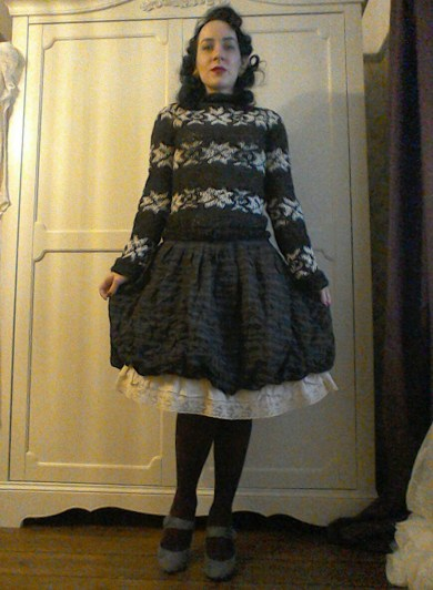 Dark jumper with checked skirt and frills