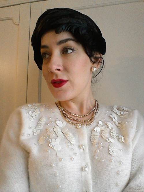 Vintage pearl necklace and embellished cardigan