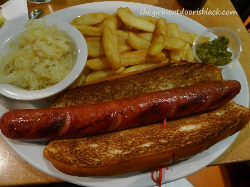 Hot dog with sauerkraut at Juniors Restaurant Times Square | The Girl Next Door is Black