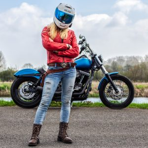 The Girl On A Bike in an HJC RPHA 70 full face motorbike helmet