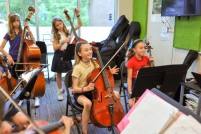 Students playing cello and violins