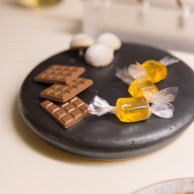 Chocolate minibar (*rim shot*), raspberry-wasabi bon bon, saffron pate de fruit in edible wrapping.