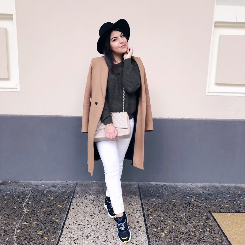 sneakers outfit camel coat
