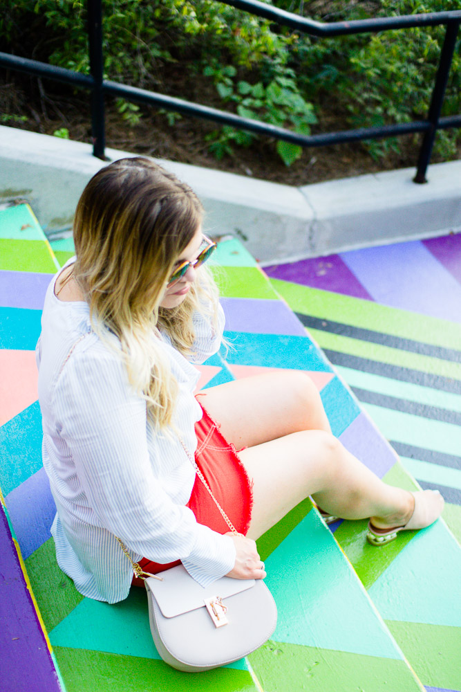 The Glitter Gospel Blog sharing an orange denim skirt and colorful backdrop. Orange denim skirt, topshop, jeffrey campbell pearl heel slides, University of Tennessee, Geometric Steps, Zara, Chloe Drew Dupe - Orange Denim Skirt by Tennessee fashion blogger The Glitter Gospel