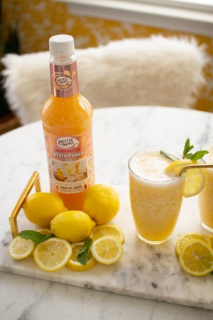 Popular Tennessee blogger Lacey Anne Douthat of The Glitter Gospel shares her amazing recipe for Frosted Peach Lemonade with Master of Mixes.