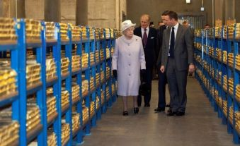 A file photograph of Britain's Queen Elizabeth touring a gold vault during a visit to the Bank of England. Reuters
