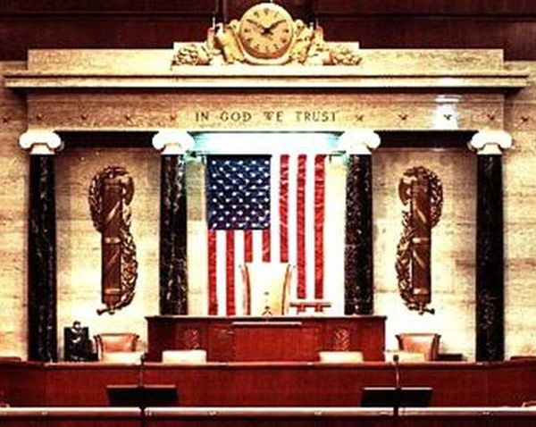 "Here is a portrait of the podium in Congress: The symbols on either side of the dais are Fasces. ""fascïs, 'bundle of rods', bound together by red thongs and carried on their shoulders by lictors before important Roman magistrates as a symbol of their power."