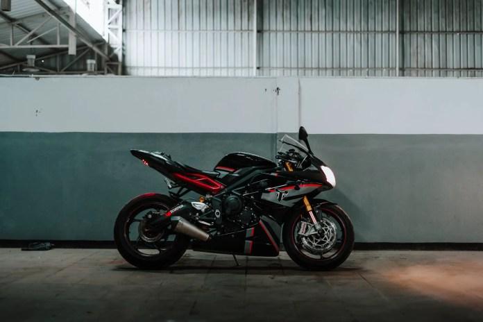 photo of parked black and red triumph daytona sports bike