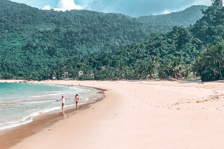 Kids walking on a beach in Tioman, Malaysia, perfect for family travel on a budget