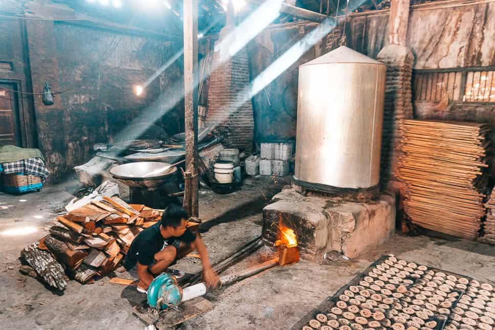 Guy working in a local krupuk factory near Yogyakarta