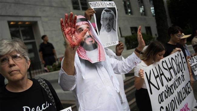A demonstrator dressed as Saudi Crown Prince Mohammed bin Salman (C) with blood on his hands protests outside the Saudi embassy in Washington, DC after Khashoggi went missing.