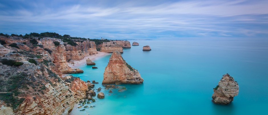 Beautiful seascape with unreal sky blue colors. Portugal, Algarv