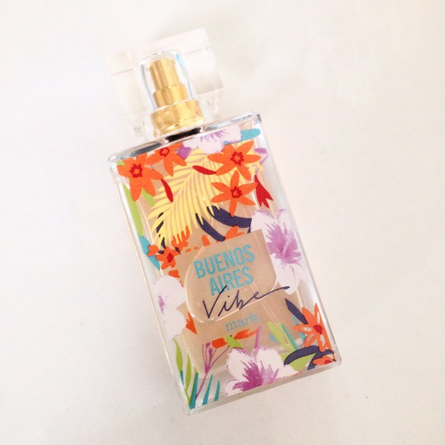 glass bottle of perfume with wild and colorful floral print