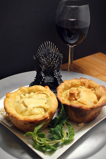 Pork Pies with White Cheddar and Pine Nuts from the Purple Wedding, inspired by George R.R. Martin's Storm of Swords. Recipe by The Gluttonous Geek.