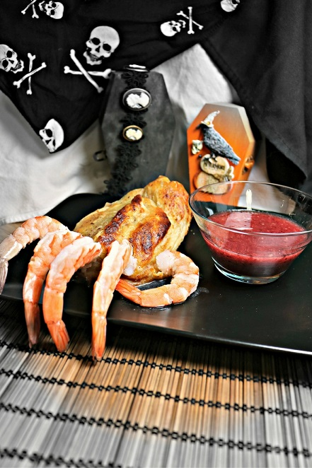 This Beetlejuice inspired recipe Shrimp Pate Wellington Hands with Cranberry Ginger Cocktail Sauce combines creepy and tasty with an Asian fusion twist. Recipe by The Gluttonous Geek.