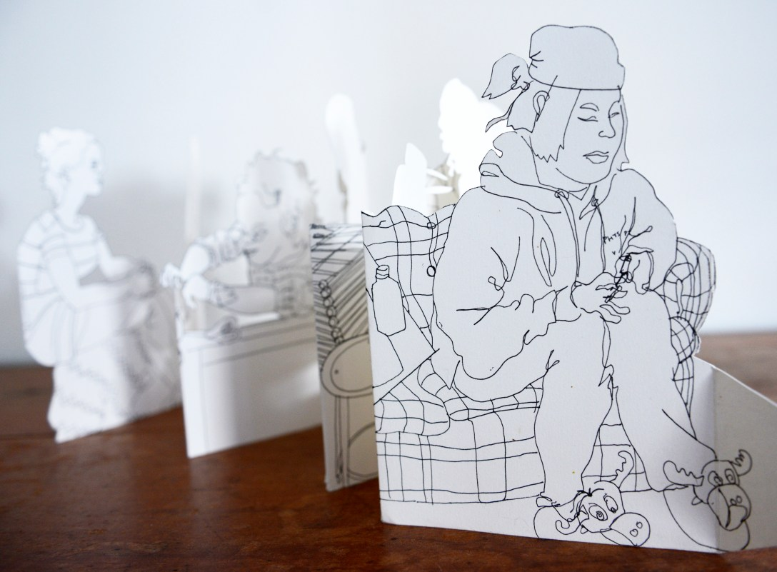 Cut paper drawing by Molly McIntyre of Libby Saylor and other friends from art college