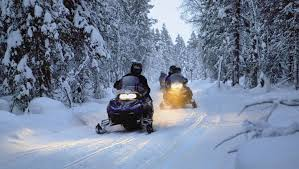 Snowmobile adventure across winter terrain