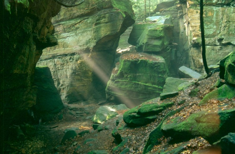 Filtered light through rock formations inside Cuyahoga Valley National Park in Ohio
