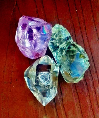 Herkimer Diamond and Andaras out of direct sunlight reveals rainbow inside Pink Andara
