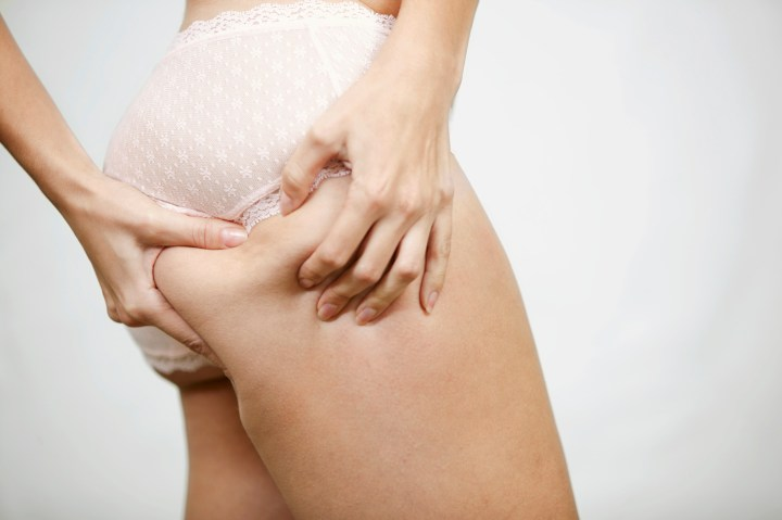 Woman Grabbing at Her Buttocks