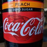 Peach Zero Sugar Coke bottle close up