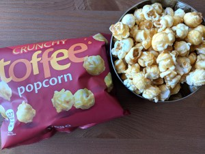 toffee popcorn in metal bowl
