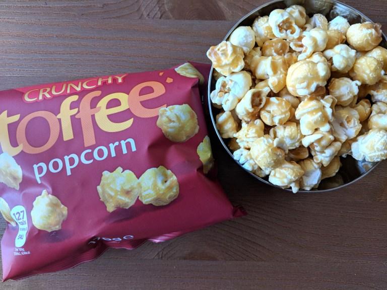 toffee popcorn in metal bowl