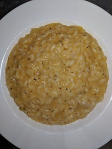 butternut squash risotto on white plate