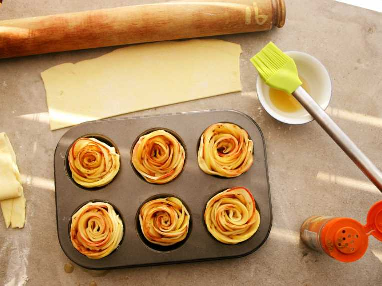 Apple roses in a muffin tin, ready for the oven