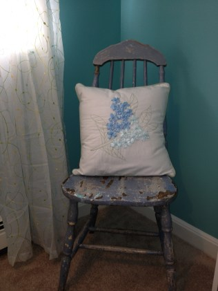 photo of vintage chair and pillow