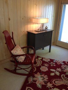 Photo of rocker, area rug, table lamp and custom cabinet