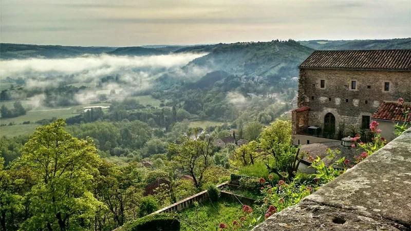 Clouds drift along the hilltop village of Cordes-sur-Ciel in the south of France