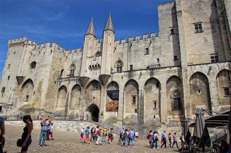 The Papal Palace of Avignon, white stone, turrets and towers