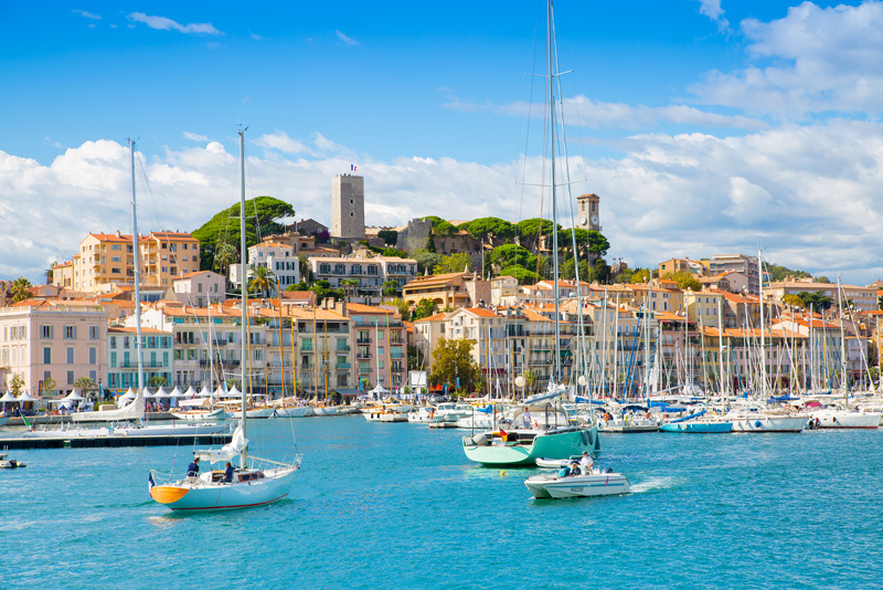 Boats bobbing on the tranquil sea in the port of Cannes, southern France on a sunny day