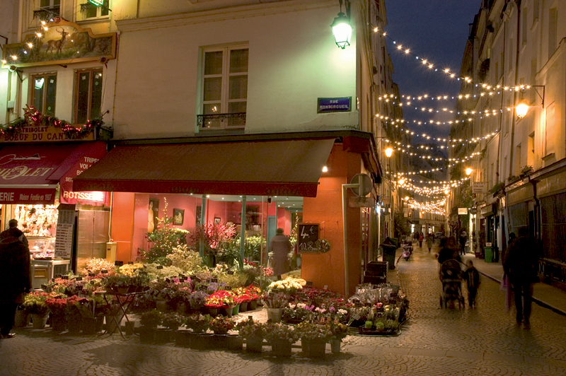 Rue Montorgeuil, an ancient cobbled street in Paris, decorated with Christmas lights