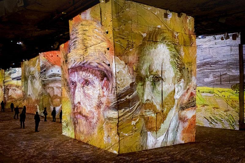 Van Gogh self portrait projected in giant format onto walls