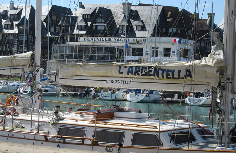 Yacht Club at Deauville Normandy, small but packed with boats marina, neo Normandy style buildings