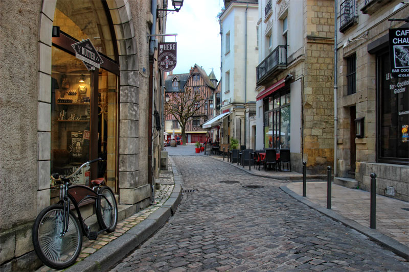 Cobbled street in Tours, Loire Valley, ancient half-timbered houses and smart boutiques line the street