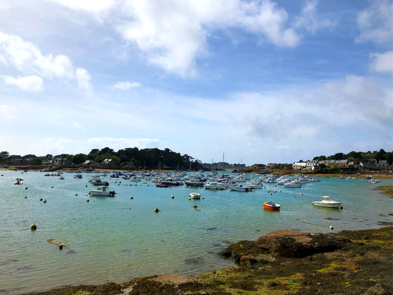 Seashore of Cotes d'Armor, Brittany, small boats in a clear sea