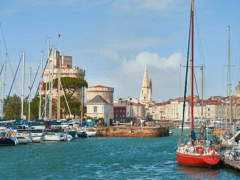 Port of La Rochelle, boats bobbing about under a blue sky