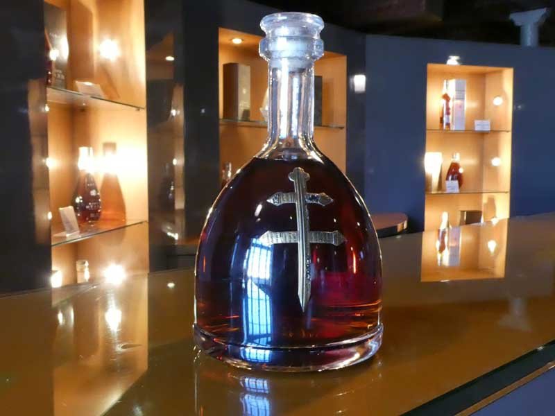 Bottle of Cognac on a counter at a tasting bar
