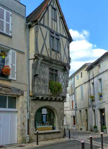 Half timbered houses in a street in Cognac, France