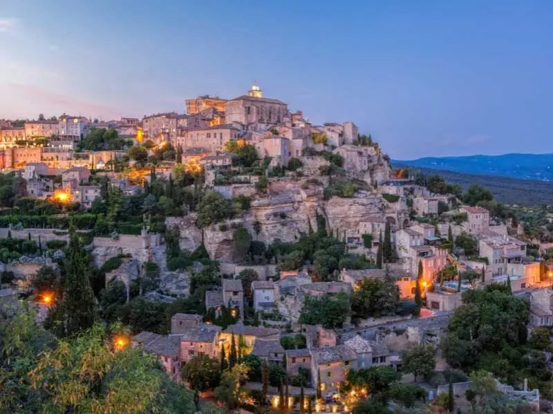 The hilltop town of Gordes in Provence lit up at twilight