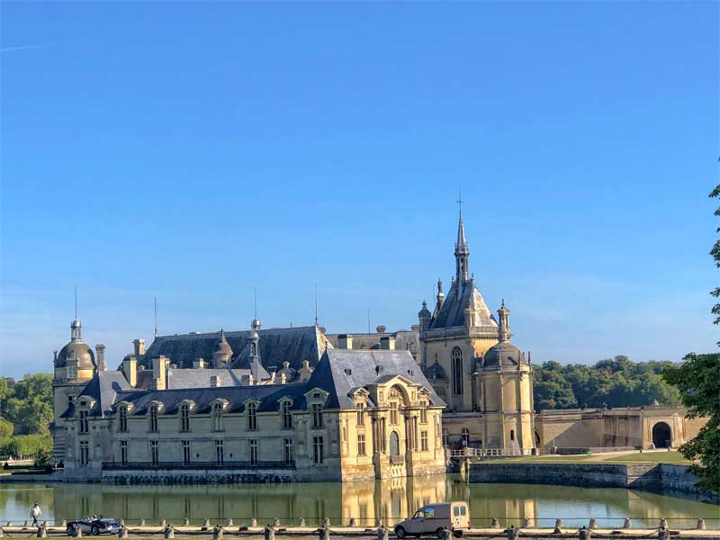 Chateau of Chantilly surrounded by a lake, Picardy